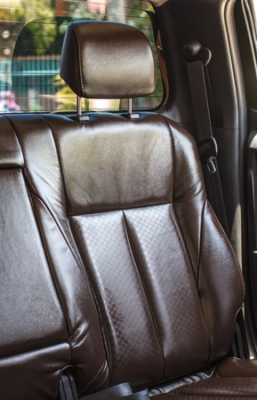 Modern car interior - rear seats with the seat belts Stock Photo - 21453152