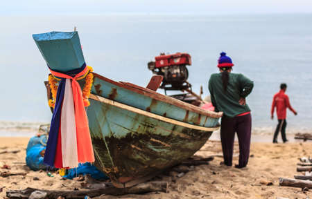 Fishermen preparing the boat out to sea. Stock Photo