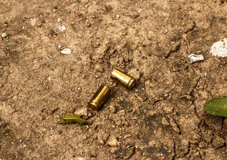 casing: An used casing is lying in the dirt