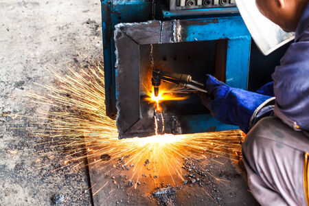 Worker cut steel large box with light  photo