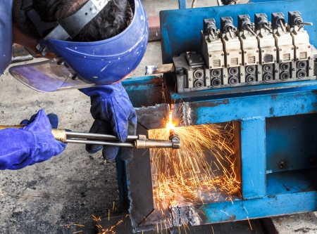 Worker cut steel large box with light