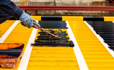 People are painting steel