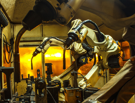 Welding robots in factories industrial