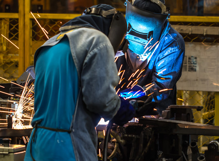 Welder with good teams Stock Photo