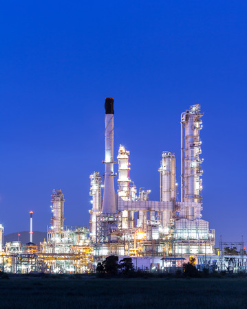 Oil refinery plant at twilight dark blue sk photo