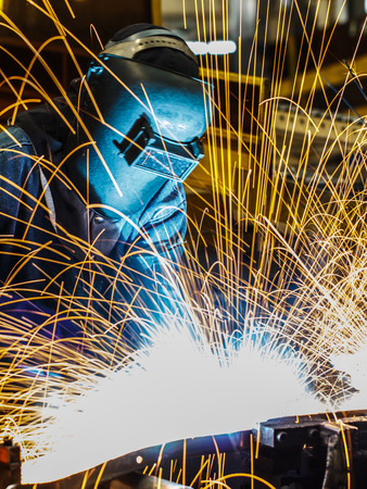Industrial steel welder in factory
