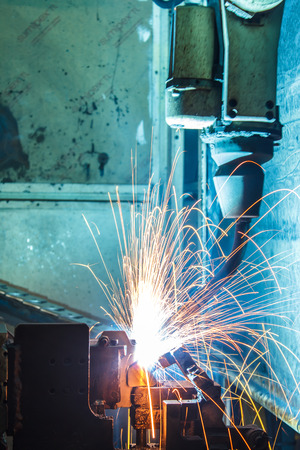 The movement of the welding robot in a car factory Stock Photo