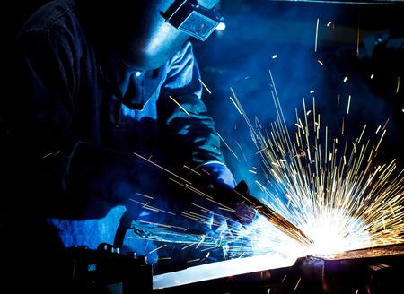 welding: Industrial steel welder in factory