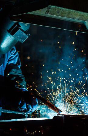 improvisation: Industrial steel welder in factory