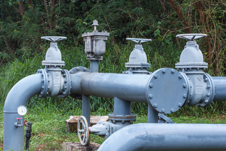 Large iron pipe valve supply pipeline Stock Photo
