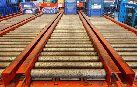 package boxes on industrial conveyor line. Stock Photo