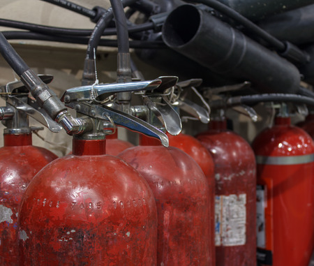 extinguishers: Red fire extinguishers available in fire emergencies.