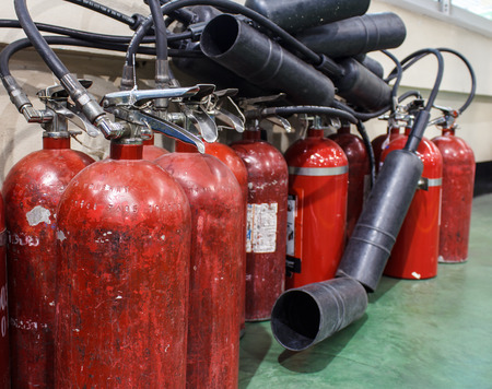 fire extinguishers: Red fire extinguishers available in fire emergencies.