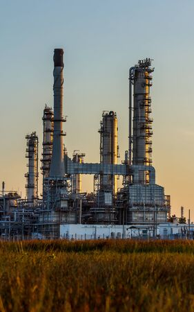 tall chimney: Refineries in the daytime.