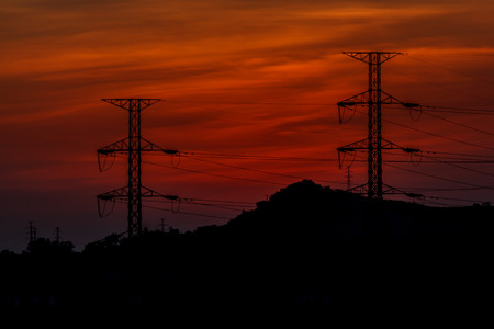 Power transmission line with the sun in the evening.