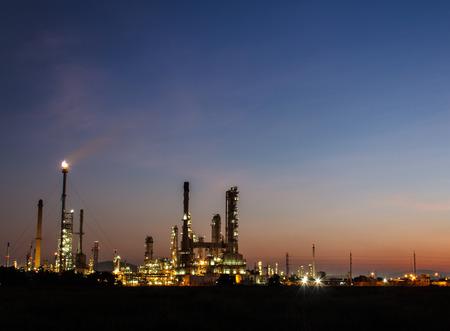 Oil refinery plant at twilight dark blue sky