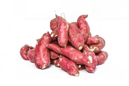 starchy food: Red sweet potatoes yams in bulk at the farmers market Stock Photo