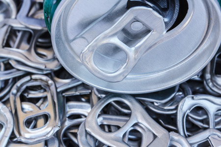 crushed aluminum cans: Metal cans and tins prepared for recycling