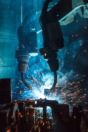 car factory: robots welding in a car factory