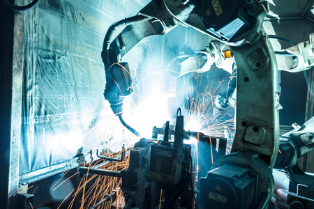 manufacturing: Welding robots movement in a car factory