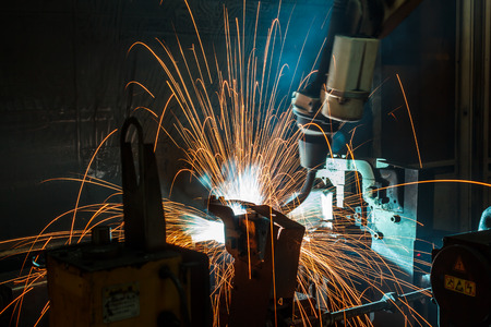 The movement of the robot welding in an auto parts factory.