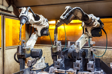automation: Team welding robots represent the movement in the automotive parts industry