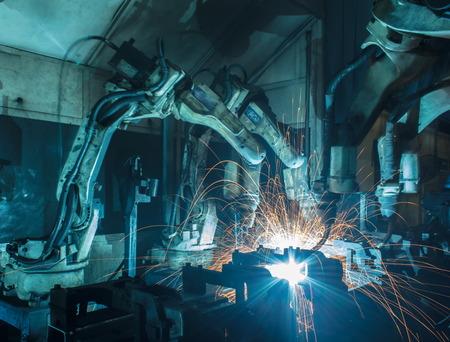 Soudage mouvements du robot dans une usine de voiture Banque d'images - 44962587