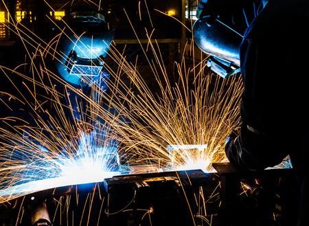 welding: worker with protective mask welding metal