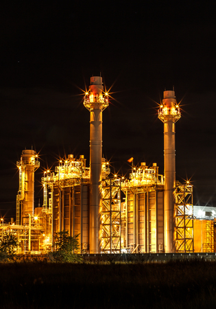 electricity substation: Large power plant at night