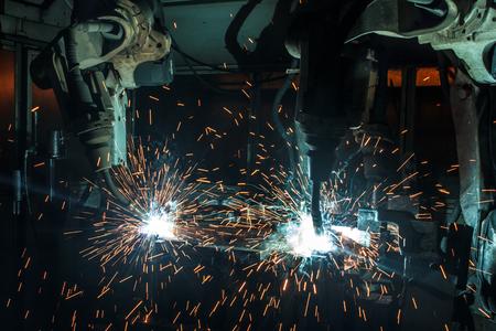 welding machine: The movement of the three welding robots welding car parts factory.