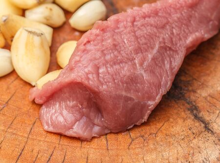 Fresh raw meat with spices close-up. Sliced Beef Stock Photo