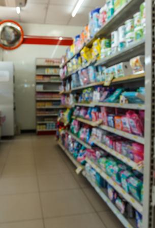 aisle: Empty Shelves of supermarket aisle,motion blur