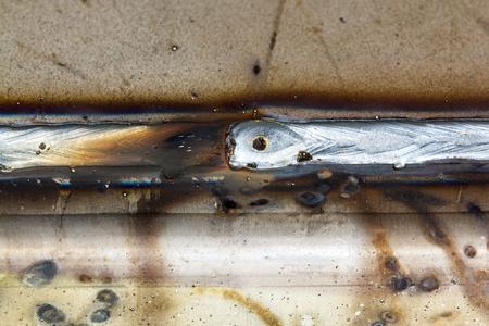 welded: welding seam onto steel sheet metal Industrial steel welder in factory Stock Photo
