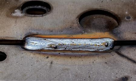 sheet: welding seam onto steel sheet metal Industrial steel welder in factory Stock Photo