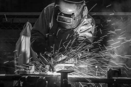 welded: welder Industrial automotive part in factory