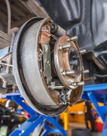 brakes: maintenance car brakes hub in garage Stock Photo