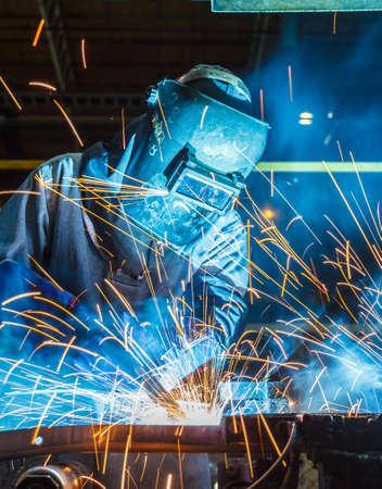 Industrial steel worker speeds motion in factory Stock Photo
