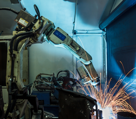 represent: welding robots represent the movement. In the automotive parts industry.