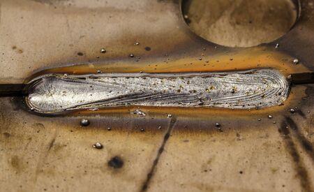 porosity: welding seam onto steel sheet metal Industrial steel welder in factory Stock Photo
