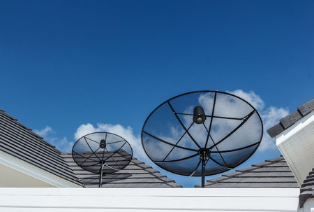 Satellite dishes communication technology network with sun and white cloud