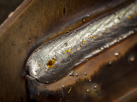 welding seam onto steel sheet metal Industrial steel welder in factory Stock Photo