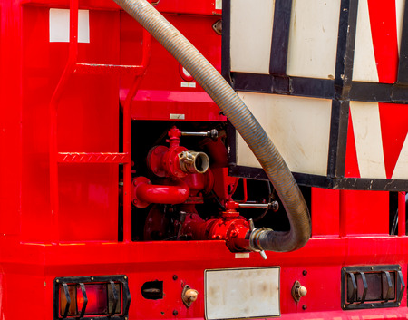 Equipment for fighting vehicle extinguishing Nozzle Fire truck. Stock Photo