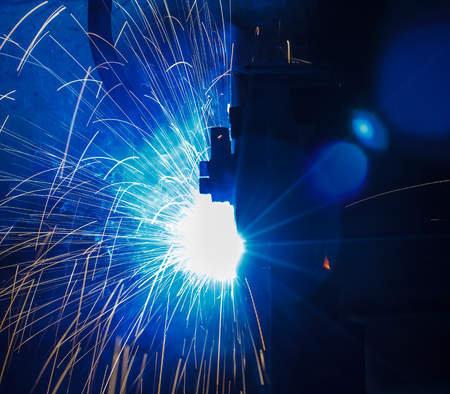 automate: The welding robots represent the movement in the automotive parts industry Stock Photo