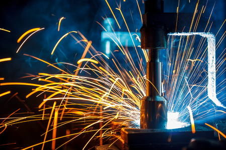 The welding robots represent the movement in the automotive parts industry Stock Photo