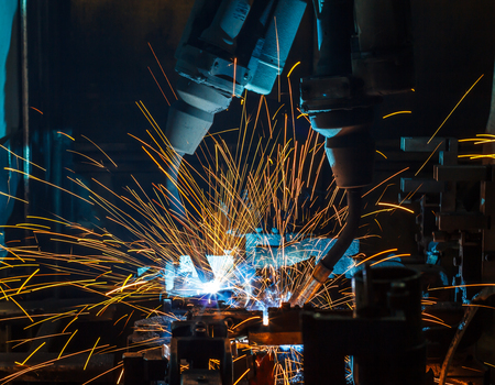 automate: Team welding robots represent the movement. In the automotive parts industry. Stock Photo