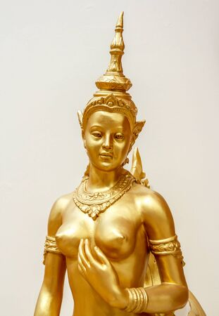 Kinnaree golden statue beautiful of white background in wat thailand