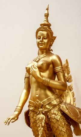 the grand daughter: Kinnaree golden statue beautiful of white background in wat thailand