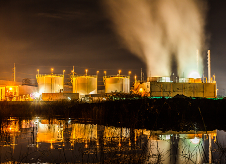 Storage tanks for natural gas and oil industry in the early dawn. Stock Photo