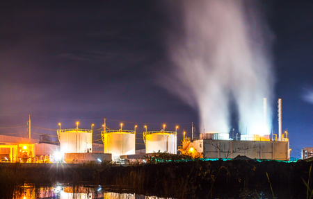 The Storage tanks for natural gas and oil industry in the early dawn. Stock Photo