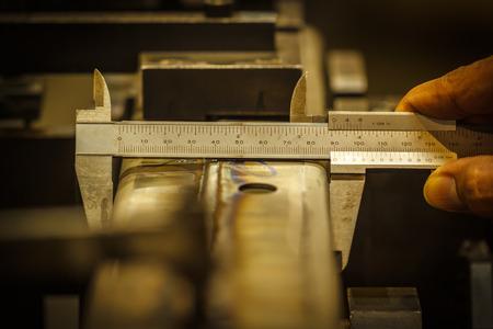 Vernier caliper measure of locate pin in auto part Stock Photo